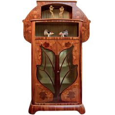 Louis Majorelle Cabinet, French, circa 1900. A rare and important vitrine by, Louis Majorelle exclusively designed for the Jansen Showroom 1902 in Paris France. The virtine is decorated with all over exotic wood and marquetry leaf and flora throughout and the center door is shaped of that of a Maple leaf which is also depicted throughout the vitrine and retains its original key.