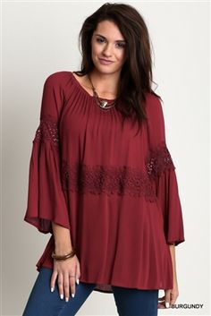 UMGEE Plus Burgundy Peasant Style Off Shoulder Tunic This curvy Bohemian loose fitting gauzy woven peasant top has an elasticized neckline, a decorative floral lace band and 3/4 length bell sleeves.This beautiful burgundy tunic can be worn on or off shoulder. XL-2X