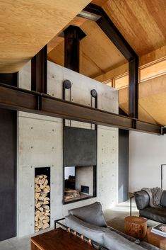 Living Room, Concrete Floor, Sofa, Two-Sided Fireplace, Wood Burning Fireplace, Coffee Tables, Console Tables, and Rug Floor Trout Lake | Olson Kundig  Photo 4 of 6 in Top 5 Homes of the Week That Rock Their Concrete Features from Trout Lake