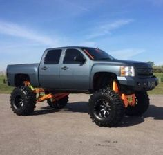 jacked up trucks chevy