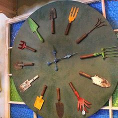 Repurposed Garden Tool Clock - using rusty old tools for the numbers, a circular piece of wood and a clock mechanism. This would be perfect in a covered outdoor space - via CuriousSofa.com Blog: GARDEN IDEAS