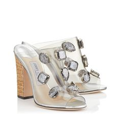 http://row.jimmychoo.com/en/collections/womens-collections/spring-summer-18/ling-110/clear-plexi-mules-with-jewels-and-rope-wedge-LING110PJR121522.html?cgid=collection-springsummer#cgid=collection-springsummer&gclid=EAIaIQobChMIlNH1xv7P2AIVi7gbCh1Z_wykEAAYASABEgLhEfD_BwE&start=1