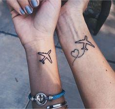 Matching plane tattoos