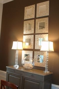 Classy glassy neutral decor. Could use this in the entry way or dining room.