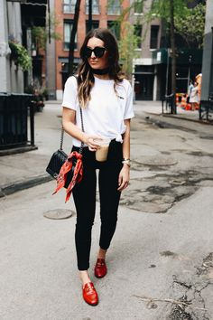 Tied up tee with black jeans and red Gucci loafers.