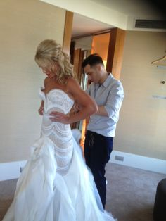 My daughter inlaw being dressed by J'Aton Couture on the morning of the wedding!! :)