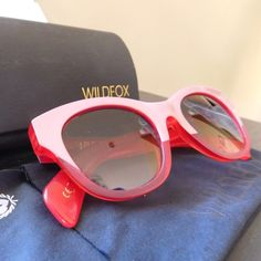 Wildfox Couture Monroe Sunglasses in Red/Pink Fabulous pink and red Wildfox sunnies with gold accents. Acetate frames with metal wiring. Quartz and brown gradient lenses. NWOT. Ships with Wildfox signature heart shaped hard case and microfiber dust bag. Wildfox Accessories Sunglasses