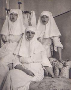 Empress Alexandra Feodorovna of Russia with her two eldest daughters,the Grand Duchesses Olga and Tatiana Nikolaevna Romanova of Russia as Sisters of Mercys.