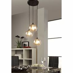 Shop for Uptown Metal/Glass Amber Globe Cluster Pendant. Get free delivery at Overstock - Your Online Ceiling Lighting Store! Get in rewards with Club O! Chandelier Centerpiece, Glass Chandelier, Modern Chandelier, Chandeliers, Dining Room Lighting, Home Lighting, Pendant Lighting, Dining Rooms, Maxim Lighting