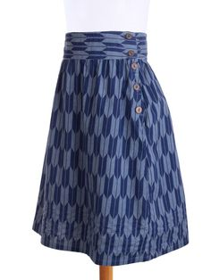 To spice up the basics in your closet wear this classic blue full-skirt silhouette flattering a wide range of body types. - hand screen-printed - hand embroidered - button closure at the seam - 100% c