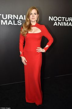 Red head turner: Amy Adams looked scintillating in a sexy scarlet gown the that Nocturnal Animals premiere in New York on Thursday night