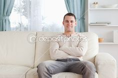Man sitting on a couch — Stock Image #11196612