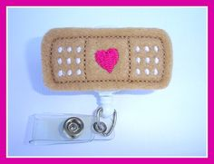 Badge Reel ID Holder Retractable - Stick it - tan dark pink white felt band aid - Nurse RN doctor pediatrician. $6.25, via Etsy.