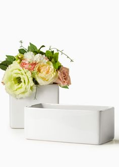 Gloss White Ceramic Cube Vase (6 1/4 x 5 3/4) $12 and Rectangle 9.5 x 4.75 in $11.  For bathroom or kitchen items.