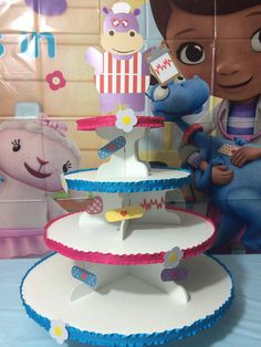 This Doc McStuffins cupcake stand is handcrafted. The stand is made of wood and the circle platforms are cake boards. This stand comes apart Doc Mcstuffins Cupcakes, Doc Mcstuffins Birthday Party, Party Finger Foods, Tassel Garland, Ideas Para Fiestas, High Chair Banner, 3rd Birthday, Cupcake Stands, Handmade Gifts