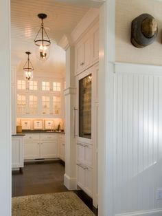 Elegant butlers pantry with built-in glass front wine fridge. Lewis & Weldon, Hyannis MA