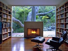 A reading space with immense windows for natural light, and a fireplace for cold nights.