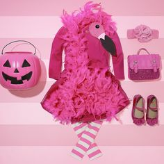 Flamingo | DIY Halloween Costume | First, create add a flamingo head to any pink boa. Next, add it to any of our adorable flamingo pink clothing and accessories. You'll end up with a totally cute (and fashionable) flamingo Halloween costume!