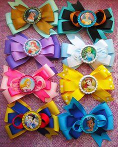 Disney princess hair bows Aurora Cinderella Ariel Pocahontas Mulan Tiana Snow White hair bow party favor girls toddlers. $4.25, via Etsy.