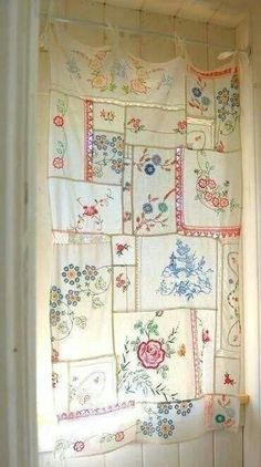 Love this curtain made for embroidered dresser scarves!!! Bebe'!!! Great repurpose project!!!