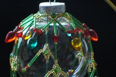 Beaded Ornament Cover - Red/Gold/Green. $25.00, via Etsy.