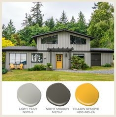 A Dark Grey Exterior And Bright Yellow Door Just Died