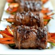 A fun, easy and adaptable recipe for pan seared steak rolls stuffed with veggies and topped with a delicious balsamic glaze steak sauce.