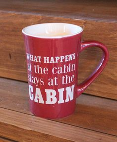 """A reminder that """"what happens at the cabin stays at the cabin!"""" This latte mug measures 5"""" tall by 5"""" wide."""