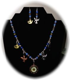 Lapis Lazuli with 1 in. diameter clock charm and multi metal bird charms and beads with matching earrings. Silver plated links and findings. Jewelry Sets, Jewelry Making, Metal Birds, Lapis Lazuli, Handmade Jewelry, Clock, Angel, Graphics, Jewels