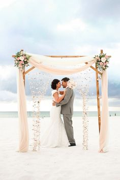 Beach Wedding Arch Ideas Beach wedding chuppah draped in pink fabric. To-Die-For Beach Wedding Ceremony Arches on Here Comes The Guide! Wedding Ceremony Ideas, Diy Wedding Archway, Beach Wedding Arbors, Wedding Ceremony Flowers, Beach Ceremony, Wedding Ceremony Decorations, Wedding Flower Arrangements, Wedding Bouquets, Wedding Arches