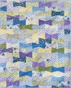 This Dapper Throw Quilt Pattern is inspired by bow ties and hair bows, and uses charm packs in sweet pastel prints and colors to create its unique design. Twin Quilt Pattern, Lap Quilt Patterns, Twin Quilt Size, Lap Quilts, Scrappy Quilts, Quilt Blocks, Tumbler Quilt, Tie Quilt, How To Finish A Quilt