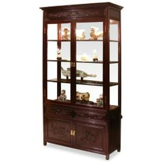 """40in Rosewood Dragon Motif China Cabinet by ChinaFurnitureOnline. $1790.00. Hand-applied dark cherry finish. Dimensions: 40""""W x 14""""D x 78""""H. Upper: three adjustable shelves behind glass double doors, mirror back, halogen lights. Lower: two drawers and a double door compartment. Our elegant rosewood curio with hand-carved dragon motif is perfect for displaying your treasured collectibles. Museum quality mirror and lighting bring out the beauty of art objects. Two doors and two dr..."""