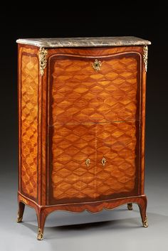 Small diamonds inlaid secretary rosewood and desultory in frames fretted amaranth. Slightly sinuous form, it opens through a flap without discovering a paper clamp inlaid with four drawers and two doors. . Tiny feet arched  Louis XV  . Ornamentation chased gilt bronze  tray breccia marble gray.