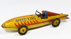"""Lot 528: Marx """"Speed King"""" Wind-Up Lithographed Tin Race Car; Having original tin driver, two stamped maker marks, including key"""