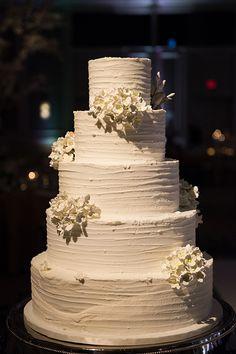 A white #weddingcake with sugar flowers | Shawna Herring Photography | Brides.com
