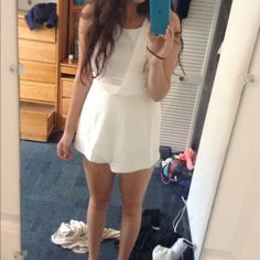 White asymmetrical romper Bought at boutique ! Adorable and wore once Cecico Other
