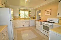 The classic 50s kitchen is bright and sunny.