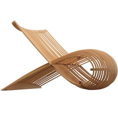 Bent wood lounge chair by now-AAPL designer Marc Newson.