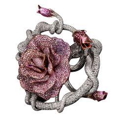 Jacob & Co. Bracciale in oro rosa e titanio con diamanti. Pezzo unico - See more at: http://www.vogue.it/vogue-gioiello/shop-the-trend/2014/06/gioielli-fiore#ad-image