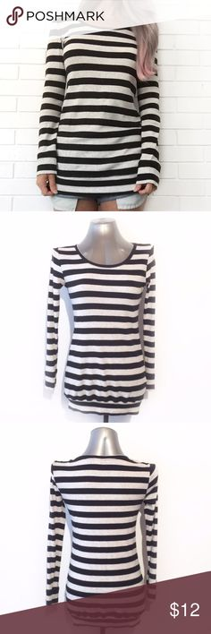 "🔴BOGO FREE🔴Divided Striped Long Sleeve Top ♦️Buy any item at list price to receive another item FREE. Please ask me to create your bundle (lesser value item will be free)♦️  ••Very good condition -no flaws••  •Round neck •Long sleeves •Gray w black stripes •Slim fit •Tunic length •Banded hem •Cotton/viscose •6  •Chest: 18"" (laying flat) •Length: 27""  •NO TRADE/HOLD  •YES BUNDLES   •PLEASE ASK QUESTIONS & READ DESCRIPTIONS. Measurements and sizing recommendations are for guidance purposes…"