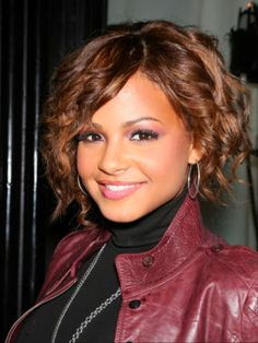 Chin length choppy hairstyles curly hair | These effortless curls and side-swept bang look amazing on this pop ...