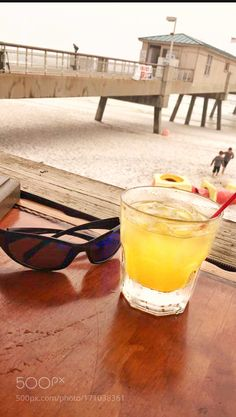 Mixed drinks and the beach by AngieSelman