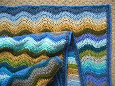 Fab tutorial on how to make a ripple crochet blanket, including weaving in the ends, border, filling in waves to complete border edges - Lucy, Attic 24