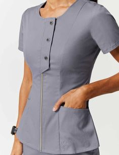 Snap Front Top in Graphite is a contemporary addition to women's medical scrub outfits. Shop Jaanuu for scrubs, lab coats and other medical apparel. Dental Scrubs, Medical Scrubs, Scrubs Outfit, Scrubs Uniform, Jaanuu Scrubs, Stylish Scrubs, Beauty Uniforms, Medical Uniforms, Womens Scrubs