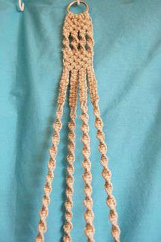 This macrame plant hanger features natural hemp cord and no beads. The beginning of the hanger is a 2 inch heavy nickel ring with a focal area that has a nice design. I then branched off into 4 arms featuring alternating square knots and twisty knots. I have a simple knotted basket at the bottom. Its made of sturdy hemp cord, not the bulky shedding jute. This listing is for the planter only, Im showing it with a 9 inch green saucer and an 8 inch tall glass vase (NOT included, sorry.) The…