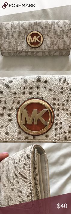 """😍MK signature wallet MK signature wallet in good PRE- OWNED condition . It is NOT NEW or """"like new . """" It was my EVERYDAY wallet . It has signs of use , some rub wear and small spots throughout . Nothing major - no major defects - just signs of normal everyday wear . SEE PHOTOS . That being said it's a really nice wallet and has a lot of use left . Check out the MK purse I'm selling 😊 KORS Michael Kors Bags Wallets"""