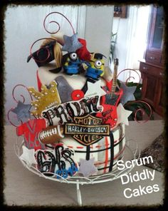 Custom graduation cake for the prom king who loves Harley Davidson, despicable me and the minions, Star Wars, and football. Made by Scrum Diddly Cakes.... Grey, red, black and white cake Plaid and diamonds Topsy Turvy cake
