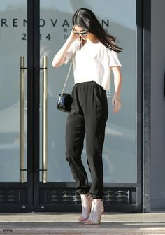 {Street style} | White tee, black pants, peep toe ankle booties, black chain link cross body bag.