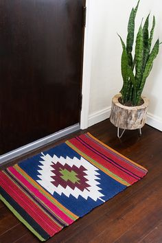 We love this hand painted kilim-style rug by Stacy Risemay of Not Just a Housewife. See the tutorial on The Home Depot Blog.