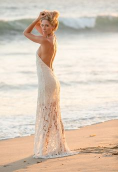 Intoxicating bride in a lace, sexy beach gown.